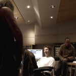 Me laying down Guitar tracks with William H. Macy looks on.
